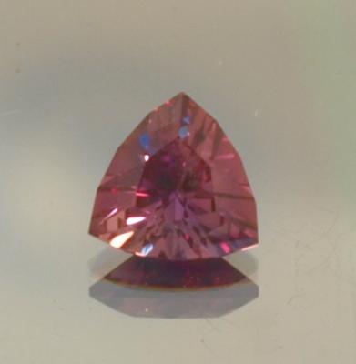 Color Shift natural tanzanian Sapphire from Songea cut in a bright triangle .55ct. 5mm.x5mm.x5mm.
